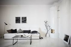 A white sitting room in a Swedish apartment.