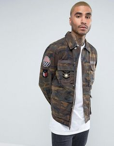 Get this Asos's spring jacket now! Click for more details. Worldwide shipping. ASOS Military Jacket in Camo Print with Badges - Green: Jacket by ASOS, Woven fabric, Point collar, Concealed button placket, Functional pockets, Badge detail, Camo print, Regular fit - true to size, Machine wash, 100% Cotton, Our model wears a size Medium and is 193cm/6'4 tall. ASOS menswear shuts down the new season with the latest trends and the coolest products, designed in London and sold across the world…