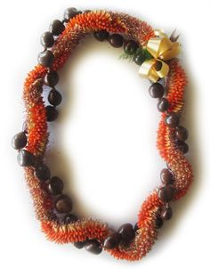 """A """"twist"""" on the classic Cigar Lei :) ~ Cigar Kukui Twist Orchid Lei, Beach Wedding Suits, Tiny Oranges, Flower Lei, Graduation Leis, Cigars, Hawaiian, Orchids, Beaded Necklace"""