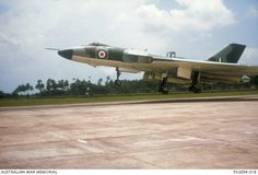 A RAF Avro Vulcan bomber aircraft lands at the RAAF base at Butterworth, Malaysia. The pilot deploys the air brakes to arrest the landing. The potential of these long range aircraft were a considerable deterrence during the Confrontation period from 1963 to 1966.