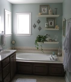 A few wall shelves & this bathroom was re-invented! Great storage idea for a small space too.