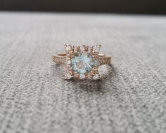 Aquamarine and Diamond Engagement Ring Halo Square by PenelliBelle THIS RING IS SO COOL! I just love how unique it is, the square cut, the gold, the everything.
