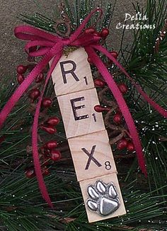 Personalized DOG Scrabble Tile Ornament w/Pewter Paw Print Charm. I could make these for each of my pets with coordinating colored ribbon to match my Christmas decor.