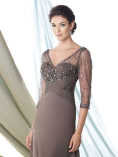 Georgette chiffon slim A-line dress with hand-beaded illusion three-quarter length sleeves, beaded illusion overlay front and back V-necklines, sweetheart bodice features beaded chiffon crisscross empire waistband, sweep train, suitable as an evening gown or for the guest of the wedding.Sizes: 4 – 20