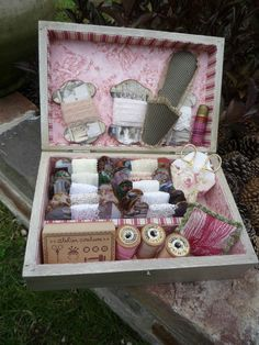 Beautifully made sewing box with vintage stuff.