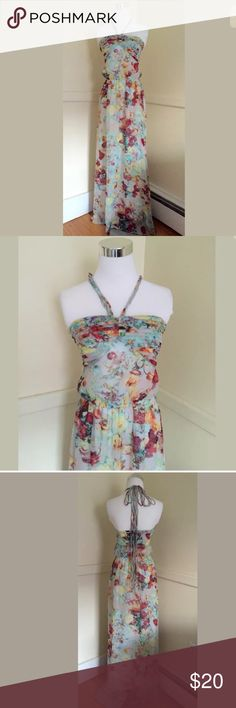 Floral sundress.  Small Size small halter floral sundress. Full length. Polyester, and rayon, and fully lined underneath the inside skirt. Full length. Will fit sizes 4/6. This dress is so comfortable. So light unknown Dresses