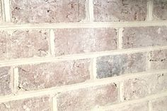 How to Whitewash Bricks - 50% paint/ 50% water, brush on and then dab with a rag off, go over with a second coat with 1/3 paint/ 2/3 water, if too much dark color is showing through