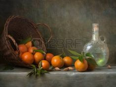 Still life with tangerines and antique bottle photo