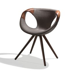 Contemporary design with a twist.  Stunning in walnut and eco leather, the Sur dining chair is leggy, unique and sophisticated.  Made in Italy, the Sur chair comes in a number of wood finishes and leather colors. #ItalianFurniture #Contemporary #CliffYoungltd #Modern #Leather #Wood #Italian #DiningChair