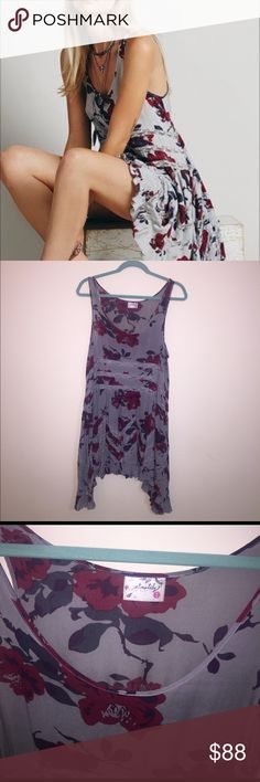Free People Lace Trapeze Grey Floral slip size M Slip is beautiful and still in great condition. This is not new and is pre-loved.   If you have any question about the piece then please ask. I can measure it on request Feel free to use the offer button to make an offer! I do not trade so please do not ask me. Remember to treat others he way you would like to be treated.  c: Free People Dresses