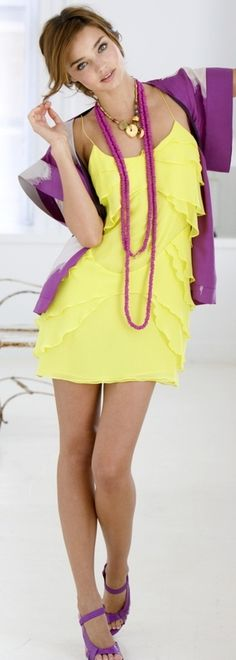yellow and purple. Perhaps a purple top and yellow skirt for those of us that yellow does not quite flatter. Dress not appropriate for work, but I like the color combination.