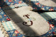 monogram pocket placemat by nanaCompany, via Flickr
