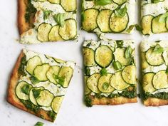 Arugula Pesto Pizza with Zucchini : Toasted hazelnuts, baby arugula and capers make a different and delicious pesto you'll want to spread on everything — not just pizza.    Get Ahead! You can make the pesto up to 1 week ahead; cover and refrigerate.