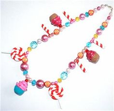 Cupcake and lollipop necklace by Lavish Accessories. #cute #kitsch #kawaii #pastel #goth #egl #sweets #cupcake #candy #lollipop #Katy #Perry #candyland