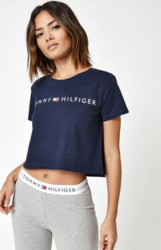 Tommy Hilfiger deliver an update to your casual style with their Logo  Cropped T-Shirt. This short sleeve tee features a crew neckline, logo graphic  at the ...