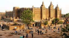 The great mosque of Djenne in Mali is one of Africa's most revered religious monuments. Constructed almost entirely from sun-dried mud bricks coated with clay, it is the largest surviving example of a distinctive style of African architecture. It has been designated, together with its immediate neighborhood of low-rise adobe houses, as a Unesco World Heritage Site.