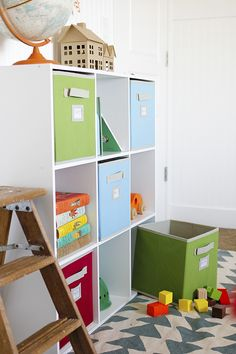 Colorful cubbies, wooden crates and stacking baskets combine to create pretty and practical storage solutions for this child's room. Alix Adams of A Ruffled Life shows us her ideas to keep the kids' room in order. These make great storage solutions for other rooms, too! || @ARuffledLife