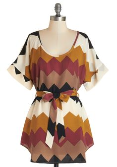 Medium Format Memory Tunic in Autumnal Chevron. From the fabulous falls tucked away in the trees, to a scenic sunset at the North Pole, you adore capturing exotic experiences in fine-grain definition with your medium-format camera. #multi #modcloth