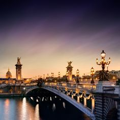 The Pont Alexandre III arched bridge in Paris, over the river Seine.