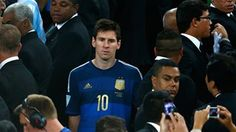 A dejected Lionel Messi of Argentina looks on after being defeated by Germany 1-0 in extra time during the 2014 FIFA World Cup Brazil Final match