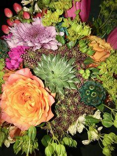 Bride's bouquet of vibrant sunset colors offers  complex-but-balanced textures.