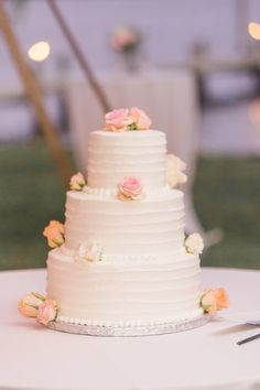 Simple wedding cake idea - three-tier, white buttercream frosted wedding cake with flowers  {Manda Weaver Photography}