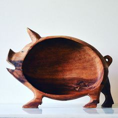 This sow's no pig in a poke: She's hand-carved, made of solid wood and even has inlaid wooden eyes. Use her as a bread or fruit basket, or stand her up on a kitchen shelf. #shopyouandyours #vintageobjects #vintagekitchen #handcarvedgifts #piginapoke #sowsear #whenpigsfly #vintagestyle