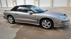2002 Firebird Trans Am ragtop: this item (on sale as of 1/1/17), the last of the Firebird/TA/V8 convertibles from PMD was clearly intended to be a time capsule. Pewter (code 11U)-over-Black-leather & top, barely break-in-mileage (~2700 mi.), the WS6 Ram Air Pkg., 6-spd. manual w/Hurst Shifter, traction control, Monsoon 500W 10-speaker sound system, 6-way power driver's seat... everything exc. the Collector Edition opt. (RPO Z15, $3000 MSRP). $34.9k USD not sounding quite so outrageous now…