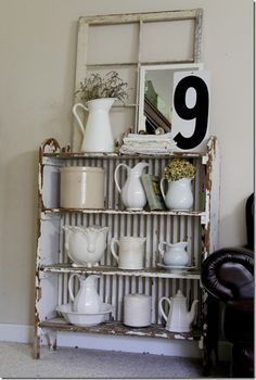 great chippy shelves, white pitcher collection, and vintage window