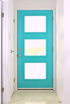 A mid-century modern inspired front door with special glass that lets in light but still provides a lot of privacy!