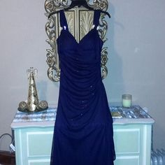 Gorgeous Betsy Adam Evening Gown Beautiful dark navy dress with gold sparkles cap sleeve and empire waist. Rhinestone hardware at the shoulders. Only worn for one event, missing one tiny rhinestone. Beautiful condition. Betsy & Adam Dresses