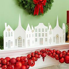 Dress up the mantel with this snowy white holiday village. Print the patterns on white cardstock, and cut out with scissors and a crafts knife. Add vellum pieces for windows, adhering on the back. Cut white cardstock scraps to look like snow drifts; coat drifts with spray adhesive and sprinkle with glitter, then attach to buildings with hot glue. Add mini wreaths from the crafts store to finish. Total price: $10/