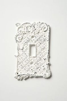 Flip your light switch on and off with this vintage Anthropologie tin roof switch plate on ShopStyle