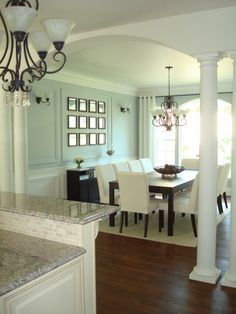 Soft blue green, white, and dark wood - great combo. Wall color is Valspar…
