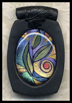 http://polydogz.com/Gallery1/Polymer-jewelry/4_G.  Be sure to go to her website and see her other works. They are beautiful!!