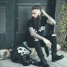 Trig Perez - such an amazing beard !! long full thick black beards mustache coloration bearded man men mens' street style fashion clothing leather jacket boots tattoos tattooed natural length bearding #beardsforever
