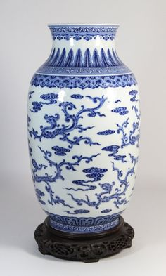 "19th C. Chinese Blue and White Vase with Six-Character Mark DaoGuang Mark. Rosewood Base. Dimension: 14 1/2""H (w/o base)"