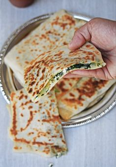 healthy cooking Gozleme is a Turkish special flatbread with different kinds of filling. This is one of my favorite with spinach and Feta cheese. This is a wonderful flatbread that is crusty outside with soft and chewy inside filled with delicious filling. Lunch Box Recipes, Veggie Recipes, Cooking Recipes, Cooking Rice, Cooking Games, Cooking Chef, Cooking Bacon, Dinner Recipes, Feta Cheese Recipes
