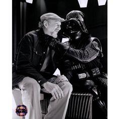 Irvin Kershner and the Darth Vader having a warm punch.