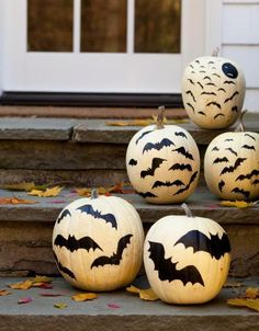 Go batty. Painted bats (or bats cut from black construction paper) look spooky on your doorstep or inside.
