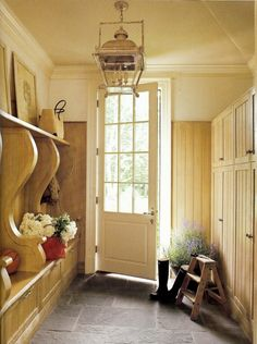 Love this mudroom:  door with 12 panes of glass, a wall of built in cupboards (small above, large below), slate floor, plenty of seating with storage underneath and a shelf above and a beautiful colonial lantern! Veranda