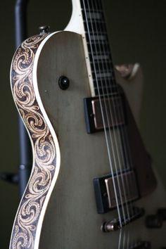 Thin body Les Paul electric guitar with wood burn scroll design on binding edge. Acoustic Guitar Notes, Guitar Art, Music Guitar, Cool Guitar, Playing Guitar, Acoustic Guitars, Learning Guitar, Guitar Logo, Ukulele