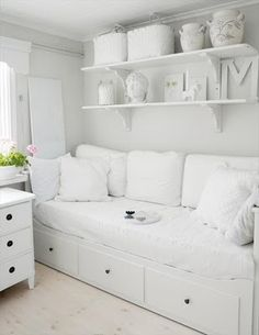 White. A floral patchwork blanket and scatter cushions would transform this into a child's room.