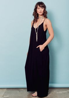 Effortless, sleeveless, crinkle gauze maxi dress featuring a deep v-neck, gathered cocoon like fit, side pockets and adjustable straps. 100% Rayon Crinkle Gauze, DRY CLEAN ONLY Model is 5'9, wearing s