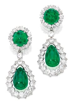 An Important and Historical Pair of Platinum, Emerald and Diamond Pendant-Earclips. The two drop-shaped emeralds suspended from two round pyramid-shaped cabochon emeralds within diamond-set frames of later addition set with round, old mine and single-cut diamonds. Provenance: The Jewels of the Romanov Family and Court.