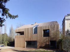 Maison French studio Avenier & Cornejo Architectes has used strips of cedar cladding to wrap every surface of this house in Orsay, France Architecture France, Wood Architecture, Classical Architecture, Residential Architecture, Cedar Cladding, Wooden Facade, House In The Woods, Design Case, House Ideas