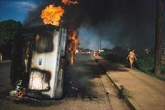 Susan Meiselas. NICARAGUA. Managua. Car of a Somoza informer burning in Managua.