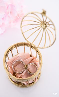 This miniature decorative birdcage is painted gold for a pretty effect! Fill with your choice of treat for an elegant favor presentation or incorporate a tag or card and use them as place card holders!