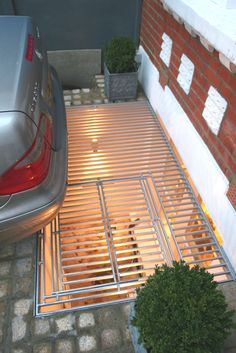 There is space for a lightwell and a car to park in this London garden.