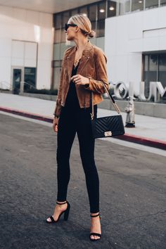 5c08a6850e Blonde Woman Wearing Blanknyc Tan Suede Moto Jacket Black Lace Cami  Everlane Black Skinny Jeans Outfit